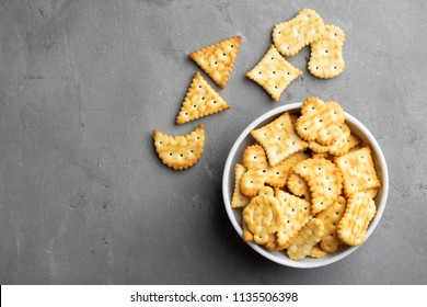 Dry salty cracker cookies on gray stone background.