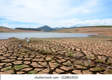 dry season with very arid terrain and little water broken soil virtually no vegetation
