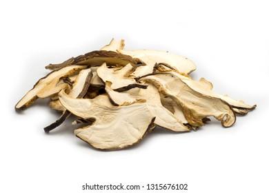 Dry sliced shiitake mushroom on white background