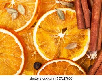 Dry slices of orange, cinnamon, allspice and cardamom