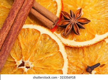 Dry slices of orange, cinnamon, cloves and cardamom
