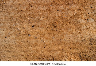Dry soil texture and background. Brown soil background. Abstract ground. Natural abstraction. Cracked soil background. Clay. Ocher