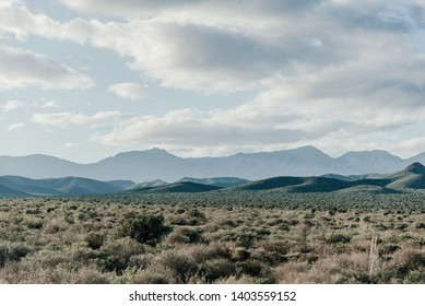 Dry South African Karoo landscape under cloudy skies