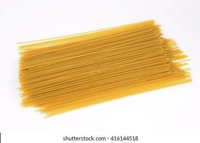 dry spaghetti on white background