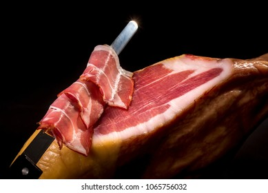 Dry Spanish ham, Jamon Serrano, Bellota, Italian Prosciutto Crudo or Parma ham, whole leg isolated on black background