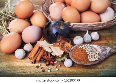 dry spice herb cinnamon stick garlic white pepper fresh egg on wood table