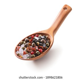 Dry spice mix with salt and black, red, green, white, allspice peppercorns in a wooden spoon isolated on white background