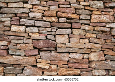 dry stacked sandstone stone wall background texture