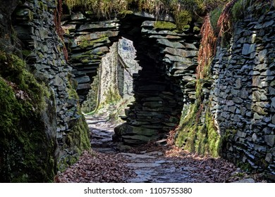 A dry stone archway and walling in the upper section of Cathedral Cavern, Lake District, England