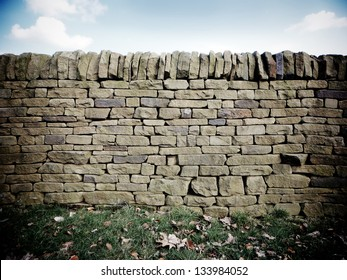 Dry stone wall with fallen leaves