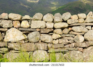 Dry stone wall in the north of England countryside in the Lake District National Park Cumbria uk traditional structure with no mortar
