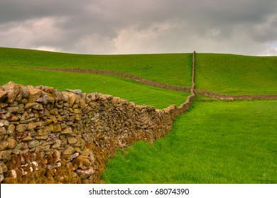 Dry stone wall on the fields in Yorkshire Dales in Great Britain