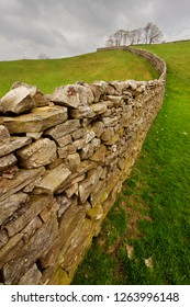 Dry Stone Wall with trees in the distance