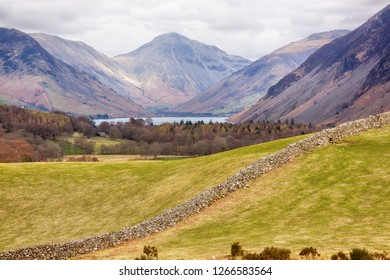 Dry Stone Wall with trees and Mountains in the distance