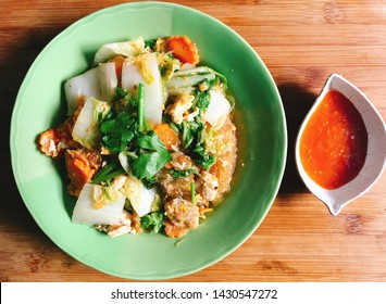 Dry Suki with chicken and vegetables (Thai style) served with spicy sauce. Thailand street food.