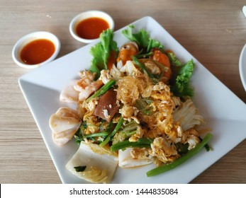 Dry Suki with chicken and vegetables (Thai style) served with spicy sauce.top view.selected focus