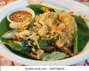 Dry Suki (Thai Style) with chinese cabbage, pork, squid, vermicelli and celery on a banana leaf, Street food.