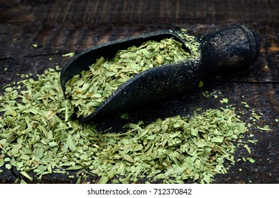 dry tarragon on wooden table