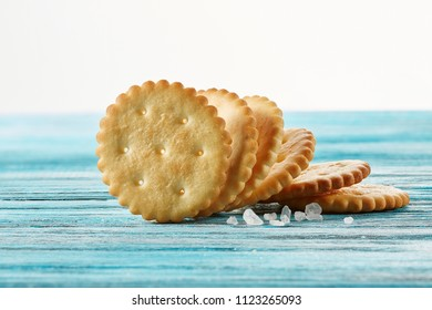 Dry thin crackers on a wooden table. Old wooden background. Tasty crispy crackers cookies. Closeup
