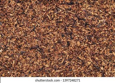 Dry tobacco leaves cut texture. High quality dry cut tobacco  big leaf, macro close up