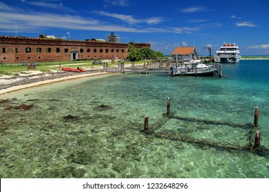DRY TORTUGAS NATIONAL PARK, FL - SEPTEMBER 14: A variety of boats and watercraft are often found docked at Fort Jefferson in Dry Tortugas National Park September 14, 2018 in Dry Tortugas National Park