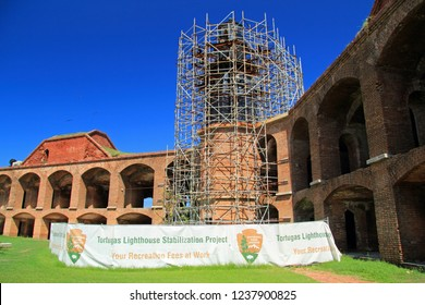 DRY TORTUGAS NATIONAL PARK, FL – SEPTEMBER 14: Garden Key Lighthouse, which sits atop Fort Jefferson, undergoes extensive restoration in 2018 September 14, 2018 in Dry Tortugas National Park, FL
