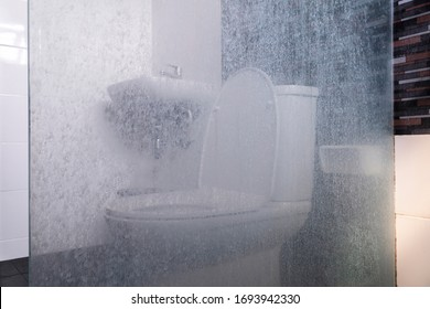 Dry water stains on the glass wall in the bathroom