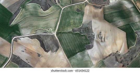 dry and wet, allegory, tribute to Picasso abstract photography of the Spain fields from the air, aerial view, representation of human labor camps, abstract, cubism, abstract naturalism,