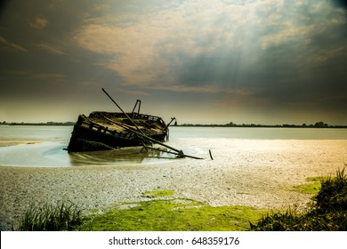 Dry and Wet: this Ship Wreck is patiently waiting for the river tides to pass near Dundalk, Co Louth, in Ireland