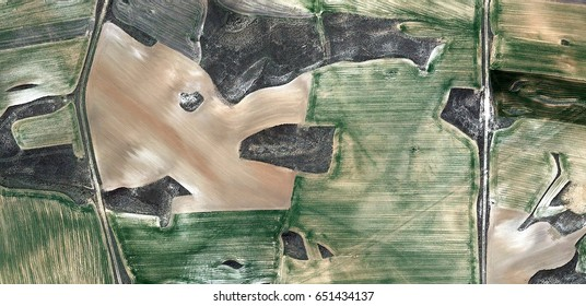 dry and wet,allegory, tribute to Picasso abstract photography of the Spain fields from the air, aerial view, representation of human labor camps, abstract, cubism, abstract naturalism,