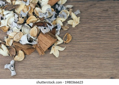 Dry white, brown and beige flowers in the wooden background, space for text