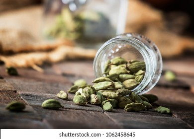 Dry whole cardamom, vintage wooden background, selective focus