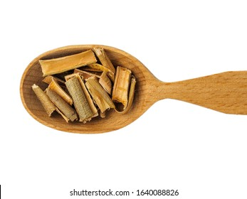 Dry willow bark in wooden spoon on white background.