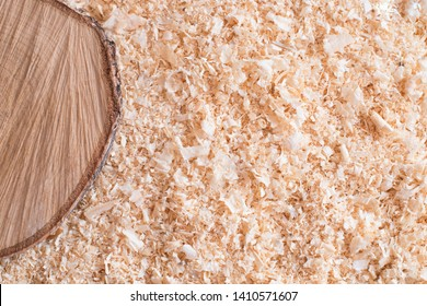 Dry wood shavings background. Wood dust texture. Sawdust pattern closeup. Sawdust floor texture. Top view. Sawdust close up with wooden cut. Wood industry concept. Eco energy design.