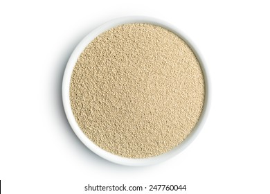 dry yeast in bowl on white background