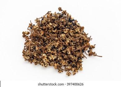 Dry Zanthoxylum limonella Alston / Thai spices on white background.
