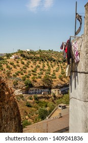 Drying clothes against the backdrop of the beautiful Spanish and Andalusian town, Setenil de las Bodegas, creating the so-called Pueblos Blancos, characterized by stylish, white buildings.
