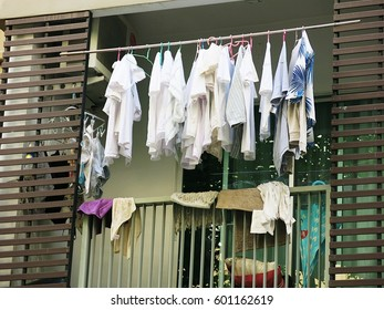 Drying clothes on the balcony of the condo on the day without the sun from the sun
