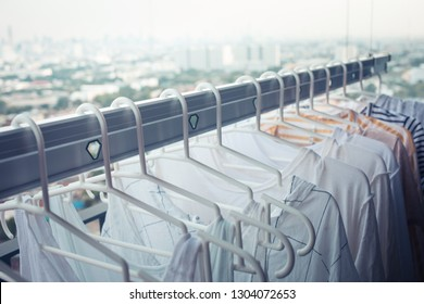Drying clothes on clothesline on condo in morning.housework and cleaning concepts ideas