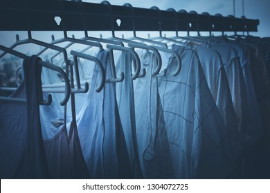 Drying clothes on clothesline on condo in nignt housework and cleaning concepts ideas