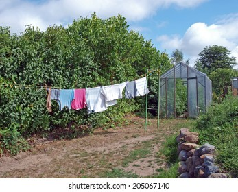 Drying clothes on the rope in country yard