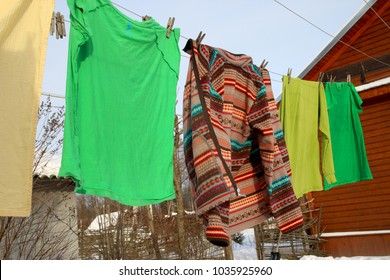Drying of colored clothes in street. Freshness morning, joy of rural life. Color fastness when washing. Stop allergies. Recommendations for siccative product. Eco-friendly, healthy, useful, economica.