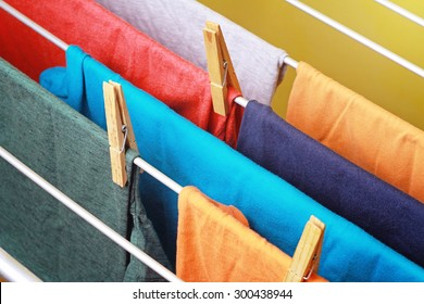 Drying colorful clothes hanged on the clothes horse