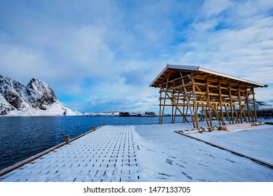 Drying flakes for stockfish cod fish in winter. Sakrisoy fishing village, Lofoten islands, Norway