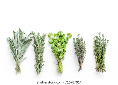 drying fresh herbs and greenery for spice food on white kitchen desk background top view space for text