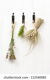 Drying herbs and lavender, hanging in rustic country kitchen