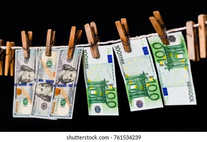 Drying of the laundered money on the black background.