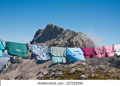Drying laundry by the Stanic cottage on the mountain in Triglav national park, Slovenia - Shutterstock ID 227231950