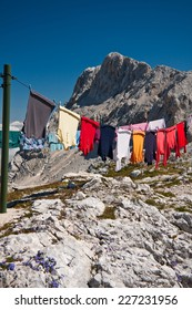 Drying laundry by the Stanic cottage on the mountain in Triglav national park, Slovenia - Shutterstock ID 227231956