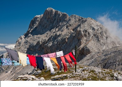 Drying laundry by the Stanic cottage on the mountain in Triglav national park, Slovenia - Shutterstock ID 227231959